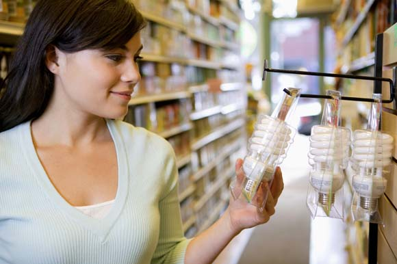 Woman looking at bath products in store
